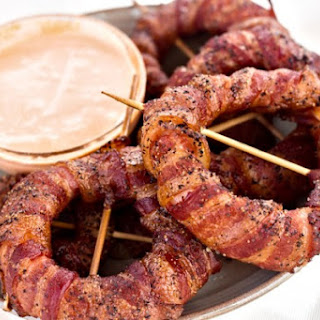 Bacon Wrapped Onion Rings with Sriracha Mayo Dipping Sauce.