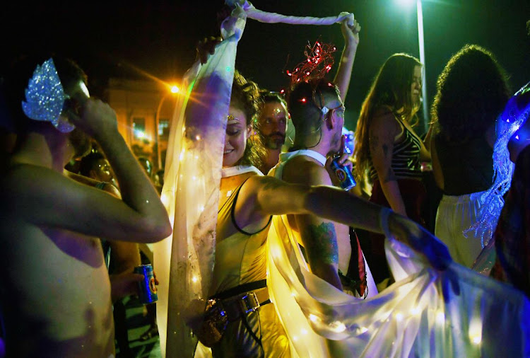 Revelers dance on the eve of the Rio Carnival, Brazil, on March 1 2019 — the first time the annual carnival takes place under the leadership of right-wing President Jair Bolsonaro. Picture: AFP/CARL DE SOUZA