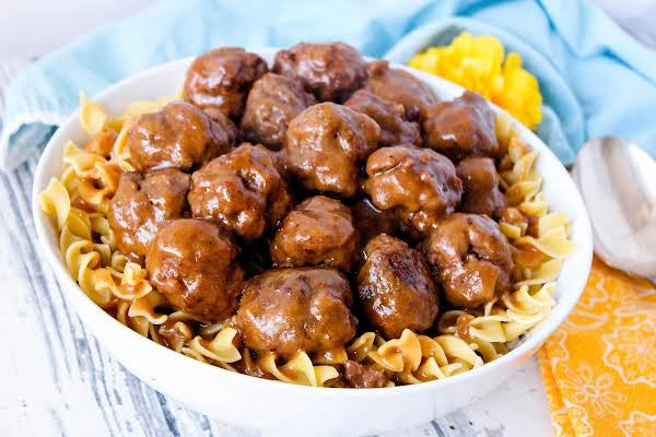 A Bowl Of Salisbury Steak Meatballs Over Egg Noodles.