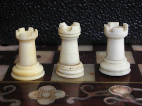 Photo: Comparison of pieces in three Cantonese ivory travel sets  Rooks  Not a great deal of difference in height. The rook on the left has 6 crennelations, as with Jaques Staunton sets, whilst the others have but 4.