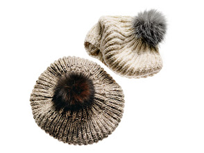 Photo: EUGENIA KIM Silk and alpaca wool hand-knit berets with fox (Finland) fur pom-pom. Silver with indigo fox or gold with dyed brown fox. $240. Also available in gunmetal with dyed black fox. USA. Main Floor. 212 872 8775