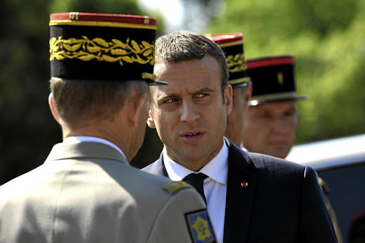 French President Emmanuel Macron, centre, speaks to an official at a ceremony marking the 77th anniversary of the late Gen Charles de Gaulle's resistance call of June 18 1940, at the Mont Valerien memorial in Suresnes, near Paris, on June 18 2017. Picture: REUTERS