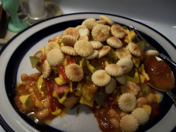 Plate With Smothered Hot Dog.