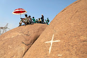 People gather in Marikana on the 6th anniversary of the massacre. / THULANI MBELE