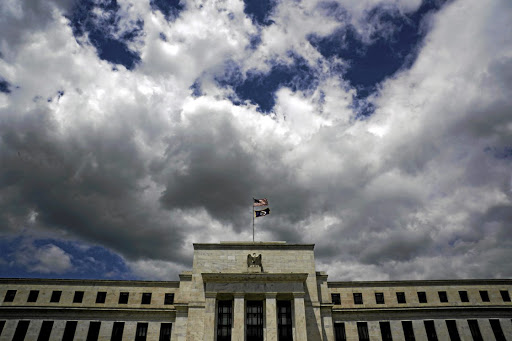 Flags fly over the US Federal Reserve headquarters in Washington. Picture: REUTERS