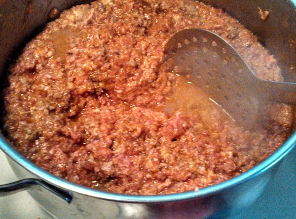after cooking and draining your ground meat, place in mixing bowl and add the...