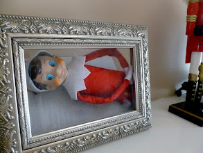Photo: December 4 - framing himself on the mantle