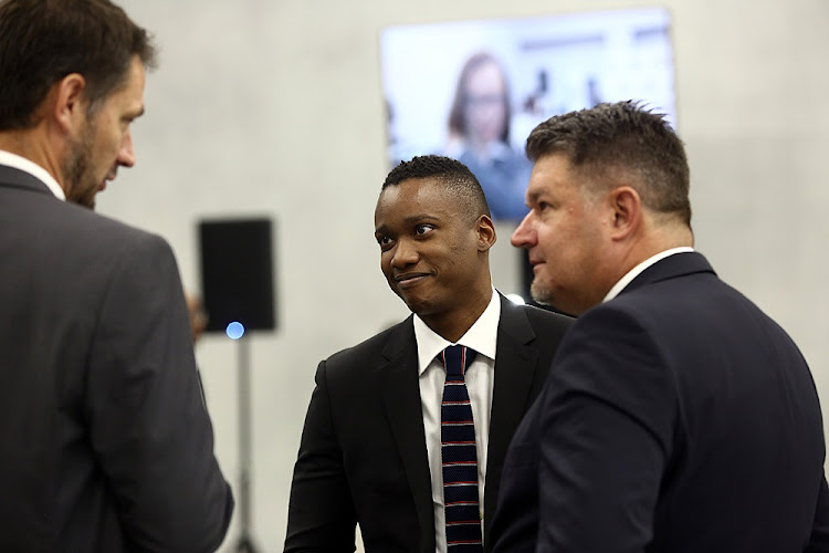 Duduzane Zuma smiles as he listens to his lawyers at the state capture commission on Wednesday.