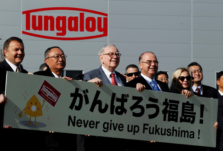 On his first visit to Japan in November 2011, Berkshire Hathaway Chairman Warren Buffett (C) posed for a photo session during the opening ceremony of a new plant in Iwaki, Fukushima Prefecture, built by Tungaloy Corp in which Berkshire Hathaway is invested. November 21, 2011. Picture: REUTERS/KIM KYUNG-HOON