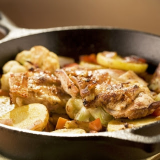 Spicy Oven-Roasted Chicken Breast with Baby Cauliflower and Potatoes.