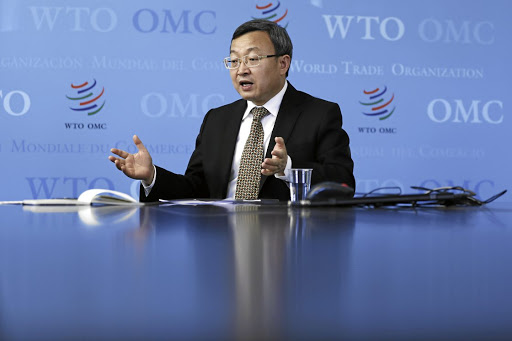 Defensive: Wang Shouwen, China's vice-minister of commerce, speaks during an interview at the World Trade Organisation (WTO) headquarters in Geneva on Wednesday. He called on WTO members to stand up to protectionism. Picture: BLOOMBERG