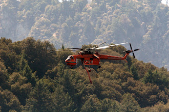 Photo: Angeles National Forest, CA  Mt. Wilson - Heavy helicopters make continued water and retardant drops to keep the fire in check while crews improve lines