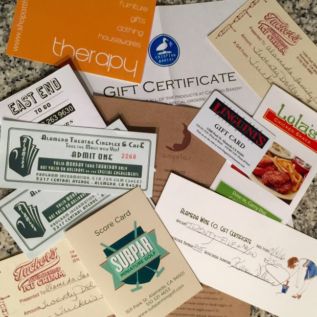 Variety of gift certificates lying on a stone counter