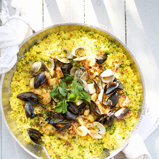 Seafood Paella with Shrimp, Scallops, Calamari and Mussels.