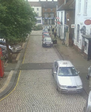 Photo: Looking along the rear of the market place area, with the taxi rank infront of the post office and cafe.