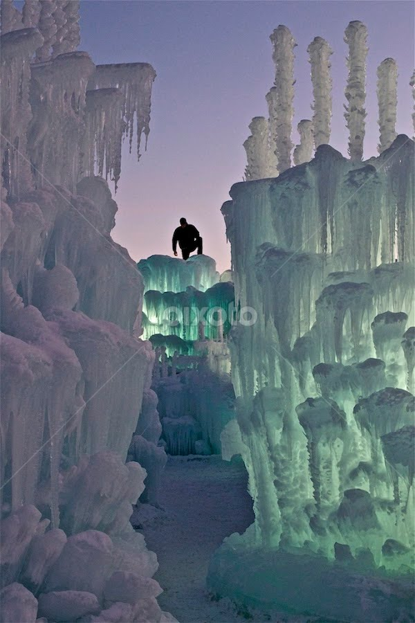 Figure atop ice castle by Heather Diamond - Buildings & Architecture Other Exteriors ( person, purple, silhouette, silverthorne, lights, figure, ice castles, blue, ice, sunset, 2011, night, evening, man,  )