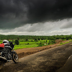 a set of wheels, tank full of gas... and a storm to chase! by Rajarshi Mitra - Transportation Motorcycles ( clouds, mp, bike, monsoon, highways, green, pulsar, india, roads )