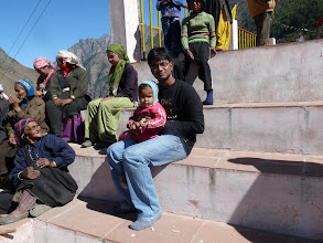 "Photo: All the village women were sitting at the temple and chatting jus some light funny talk. They were waiting for the ""prasad"" which would be alchohol and some bitter snack. I was told tht thr would be a big feast of that beheaded lamb tht day. I thought i was in a tribal remote land , but this seems to be a party Zone...:). Left the place with some thoughts about ""happiness in life"""