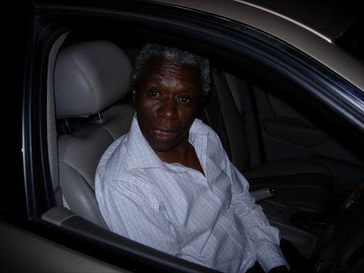 FILE PHOTO: Judge Nkolo John Motata in his luxury Jaguar at the scene of the accident where he crashed through a wall. 06/01/2007.