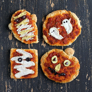 Mozzarella and Cheddar ghosts and Mummies with Sun-dried Tomato Marinara on Sesame Barley crust