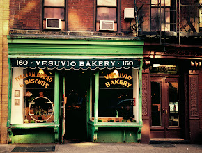 "Photo: ""Homage...""  This is one of my favorite storefronts in Soho. A little over 90 years old, Vesuvio Bakery still looks as it did for decades. A tiny bit about the original owners of the bakery is found in a newspaper article from 2003 :  ""Dapolito, 83, worked as a boy in the bakery on Prince St., decades before the neighborhood came to be known as Soho. His father and mother, Nunzio and Jennie, immigrants from Naples, opened it in 1920 and Tony went on to own it after they died.""  What is interesting about this beautiful old bakery storefront is that the bakery is no longer in the Dapolito family and has changed ownership several times since the article cited above was written. However, it is currently still operating as a bakery and the owners have kept the storefront intact.  Last year, an article was making the rounds on local lower Manhattan blogs about a recent trend that involves new shop owners paying homage to the history of a neighborhood via their store facades. The article is called: ""In Which We Mark Graves Like Birthplaces"". It calls this process authentrification. I love the term but it's a term that definitely stirs up conflict.. This process of authentrification has been happening quite a bit in lower Manhattan and the article does cite Vesuvio Bakery as being an example of this process.    New York Photography: Vesuvio Bakery, Soho.    You can view this post and its relevant links along with information about where to purchase prints of this image at my site here:  http://nythroughthelens.com/post/30527378932/vesuvio-bakery-soho-new-york-city-this-is-one  -  Tags: #photography   #Nyc   #newyorkcity   #newyorkcityphotography   #soho   #sohonyc   #city   #urban   #history   #bakery   #writing"