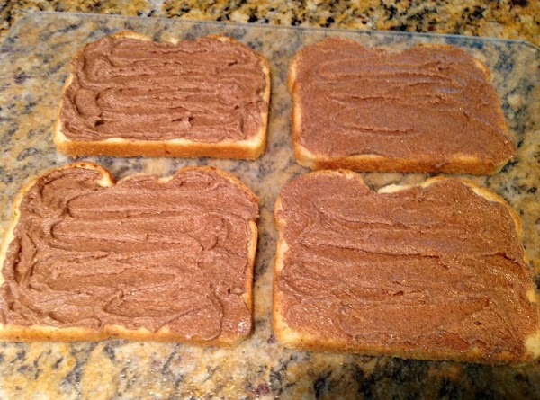 Spread the cinnamon butter on bread slices.