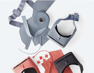 Overhead photo of Google VR hardware with fabric and other materials on a table.