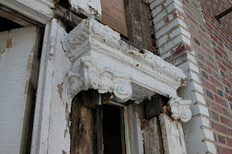 Photo: April 2006 - Month 32: Rotting capitals. Raymond re-sculpted and molded the broken and rotted trim for all of the decorative capitals - both on the front porch and on the second floor intermediate landing.