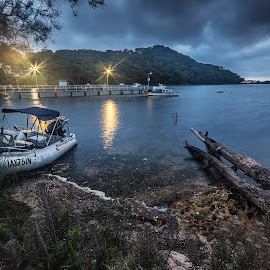 Dawn by Geoffrey Wols - Transportation Boats ( mountains, dark, dawn, pheagans bay, clouds, water, boat,  )