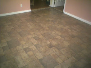 Photo: Tile laminated flooring