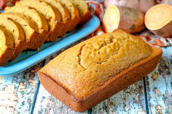 A Loaf Of Deb's Famous Sweet Potato Bread With Sliced Sweet Potato Bread.