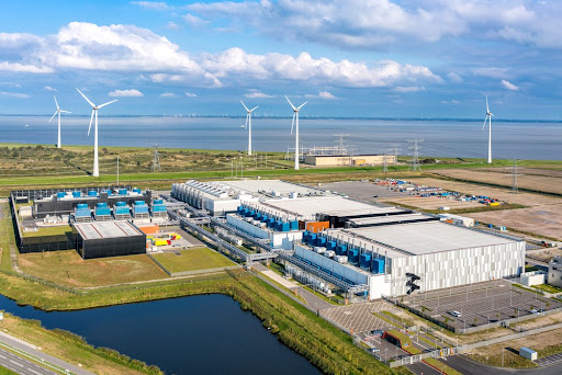 A European Google data center with wind turbines in the background.