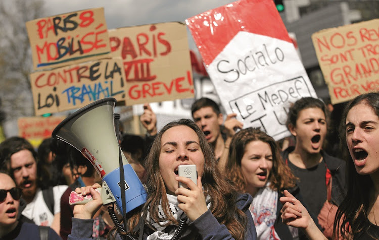 University students protest against the French government's plan to push through reforms to France's controversial labour laws, billed as an attempt to boost the failing economy before next year's presidential election. Picture: GALLO IMAGES/AFP/KENZO TRIBOUILLARD