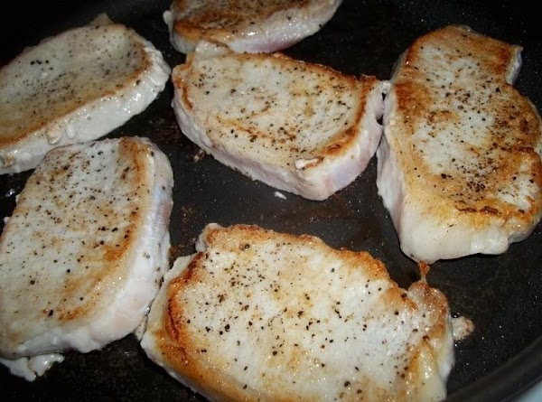 Brown chops over medium heat in oil for approximately 5 minutes each side.