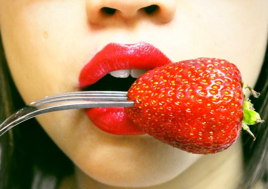 Strawberry mouth. by Eliani Miranda - Food & Drink Fruits & Vegetables ( face, fork, fruit, photograph, pwcfruit, mouth, strawberry, teeth, dslr, tasty, red, mouth lipstick, food, horizontal, lips, eat, fresa, nikon, hungry, nose )