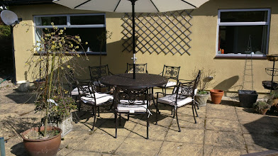 Photo: Round 8 Seater Metal Garden Set with Seat Pads and Umbrella http://www.outsideedgegardenfurniture.co.uk/Cast-Aluminium-and-Metal-Garden-Furniture/Tables-for-8/Round-8-Seater-Garden-Furniture-Set.html