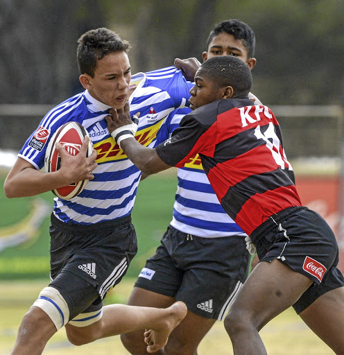 Luke Carew of Western Province tackled by Godwin Fillis of Eastern Province on day four of the 2017 U/13 Coca-Cola Craven Week at Grey College on Friday in Bloemfontein.