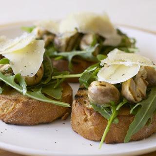 Mushroom Bruschetta with Parmesan and Arugula.