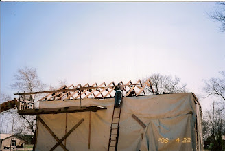 Photo: Putting the roof back on.