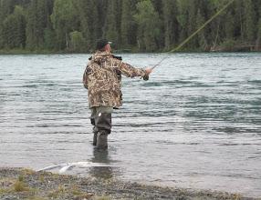 Photo: A client of Alaska Drift Away Fishing casting for Kenai river sockeye salmon.