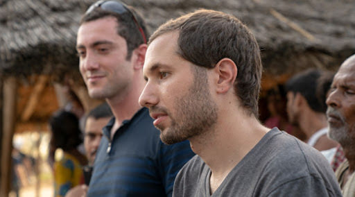 Sella Nevo and Vova Anisimov from Google Crisis Response talking with local residents in India