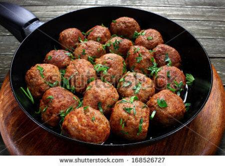 In a large skillet add vegetable oil and Cook the meatballs in batches over...