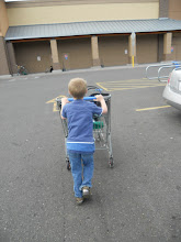 Photo: Kiddo loves to push the cart, of course it becomes a battle when Mommy needs to push it.