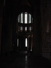 Photo: Inside the church, where its construction in stages is evident. The lower Romanesque portion has heavy walls and small windows. The upper Gothic section, with improved construction methods, allowed for larger windows. Construction on the Mount began in the 8th century, and continued in various stages through the 16th.