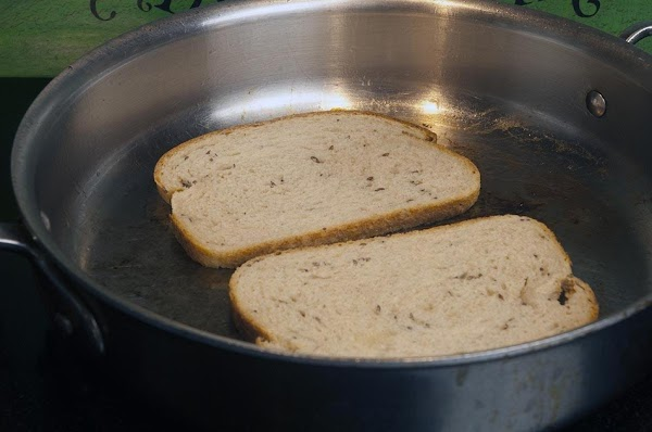 Place the skillet over medium-to-medium high heat, and then place the rye bread, butter...
