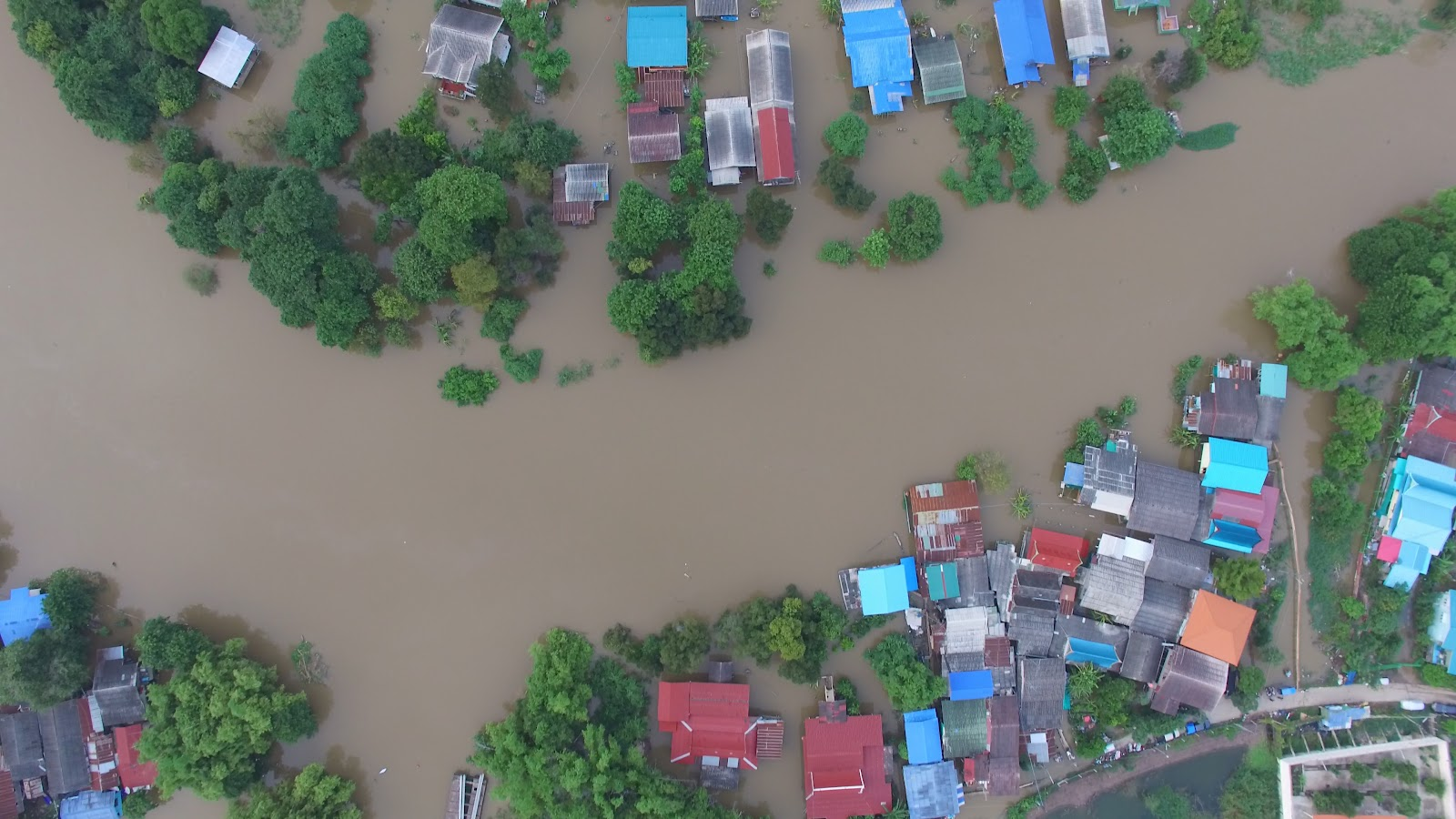 Bird's eye view of flooded homes, natural disaster, ruin