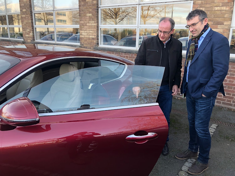Darren Day (right) gives the author a closer look at the latest Continental GT outside Bentley's head office in Crewe, England. Picture: SUPPLIED