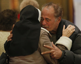 Photo: Dominican Sister Jeanine Conlon embraces John Mennella following a Nov. 7 Mass dedicated to people affected by Hurricane Sandy at St. Charles Church in New York's Staten Island. Mennella said he lost everything in his home during the monster storm that claimed the lives of three members of the parish. (CNS photo/Bob Roller) (Nov. 8, 2012)