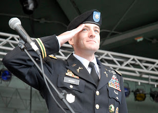 Photo: Lt. Col. Mark Weber, Minnesota National Guard, salutes during the Armed Forces Medley.  Weber was the master of ceremonies during of the 34th Red Bull Infantry Division Band performance at the Minnesota State Fair's Military Appreciation Day Aug. 30, 2011 in St. Paul, Minn.