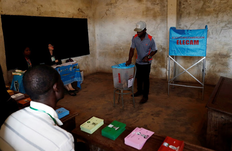 A man votes at a polling station during the presidential election, in Yaounde, Cameroon, October 7 2018. Picture: REUTERS/ZOHARA BENSEM